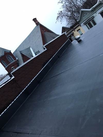 albany-roofing-repair-being-completed