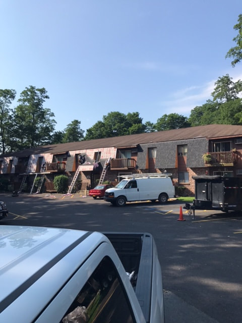 commercial roof installation on connected garages in Latham NY