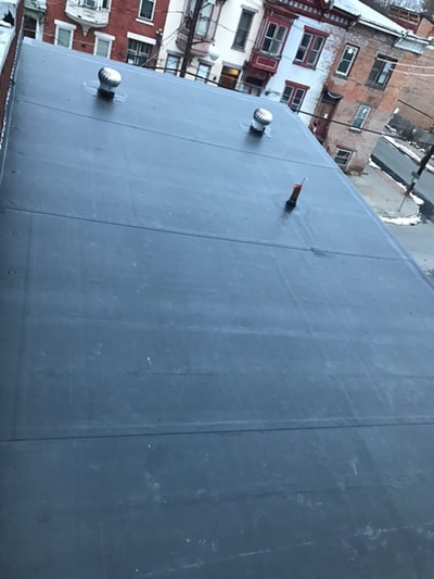 roofing-project-being-completed-in-downtown-albany-ny